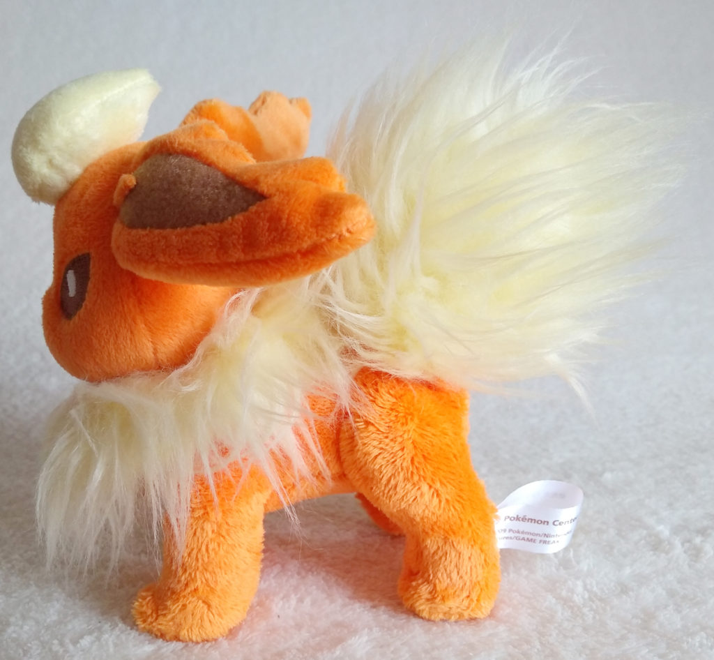 A side shot of Flareon Canvas Plush