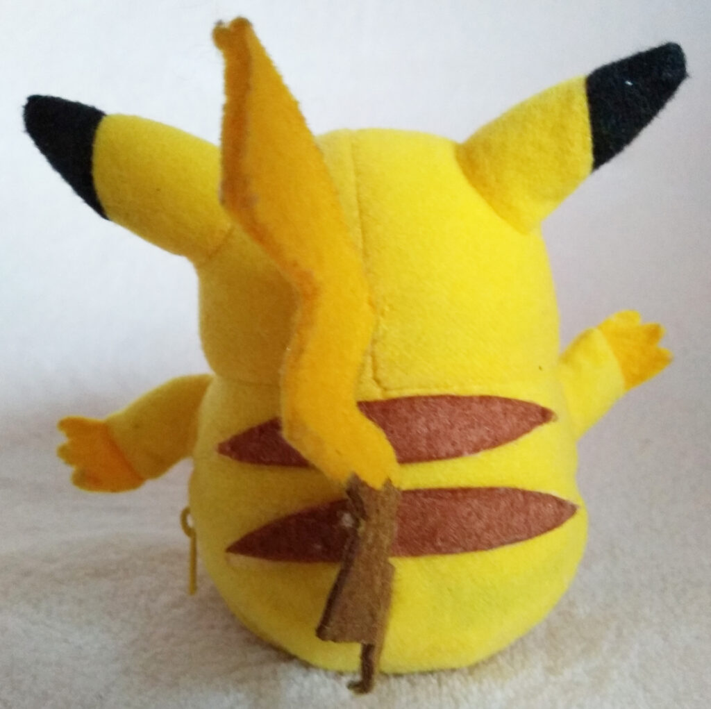 Reversible Pokéball plush by Tomy, Pikachu back