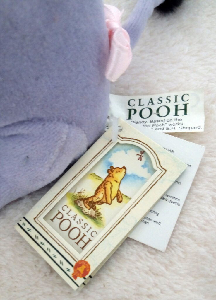 The tush and hang tags of Classic Pooh beanie Eeyore by Golden Bear