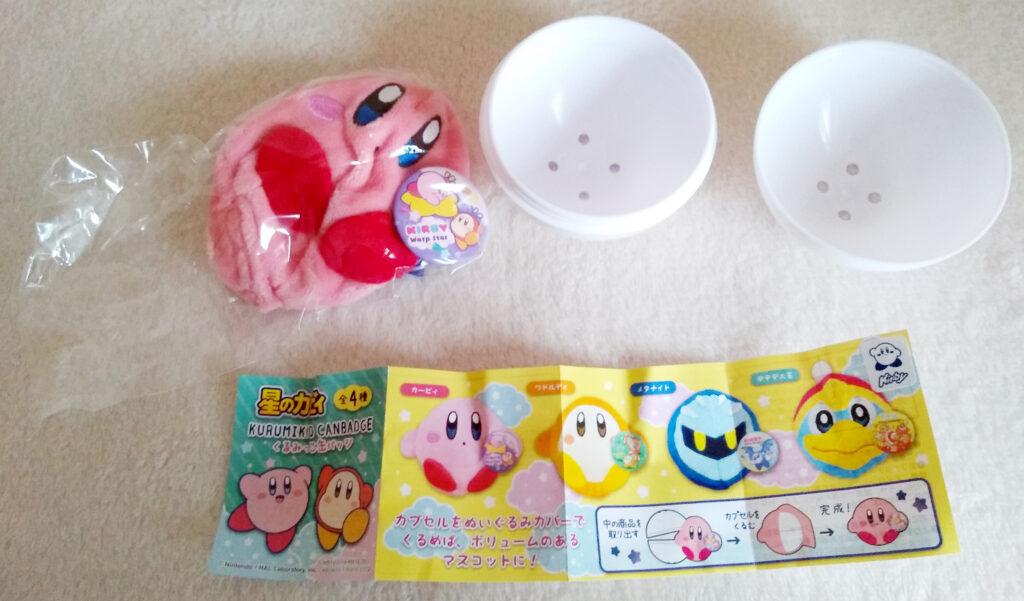 An opened Kirby Kurumikko Canbadge