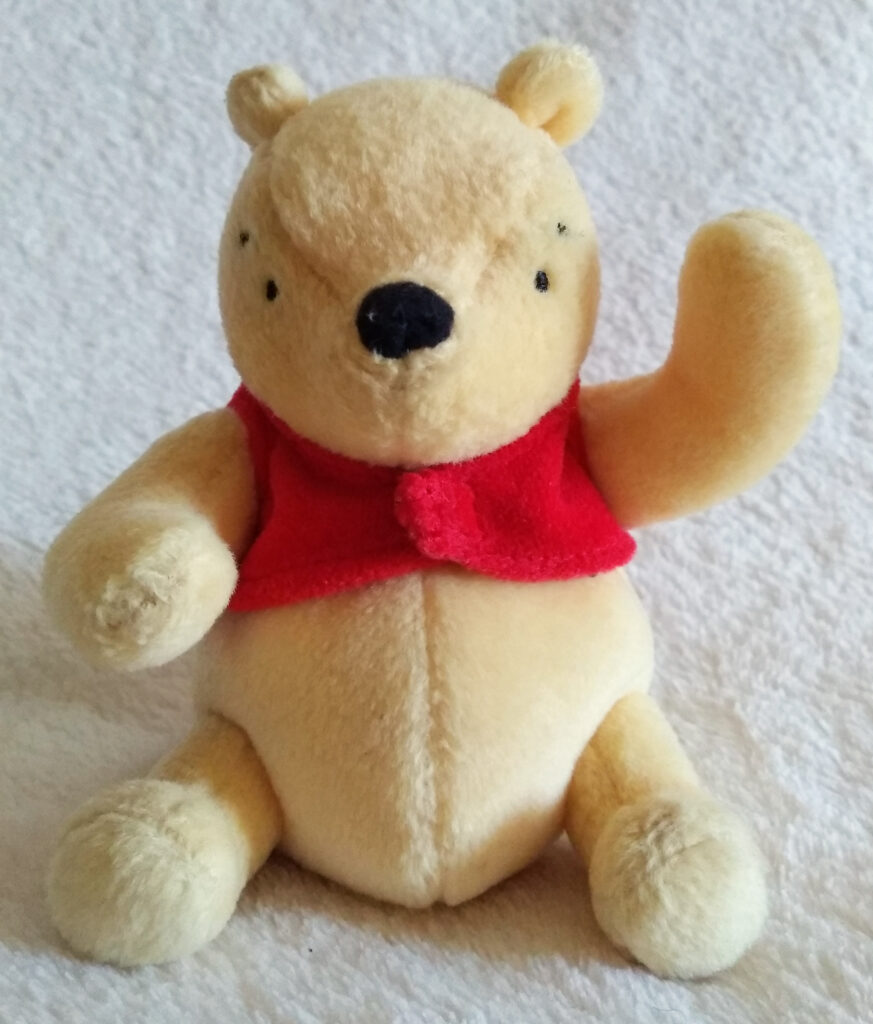 The front of Classic Pooh beanie Winnie the Pooh by Golden Bear
