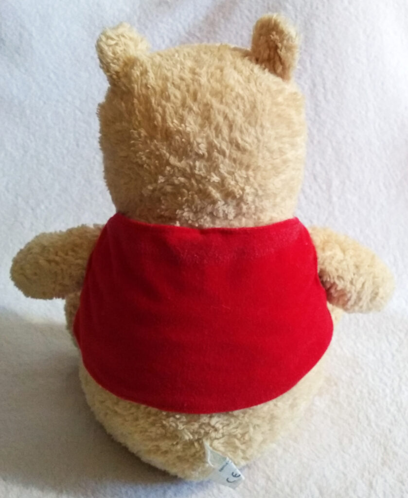 A back view of Winnie the Pooh, Classic Pooh plush by Golden Bear