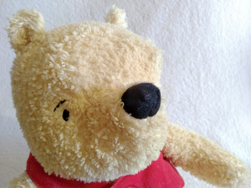 A headshot of Winnie the Pooh, Classic Pooh plush by Golden Bear